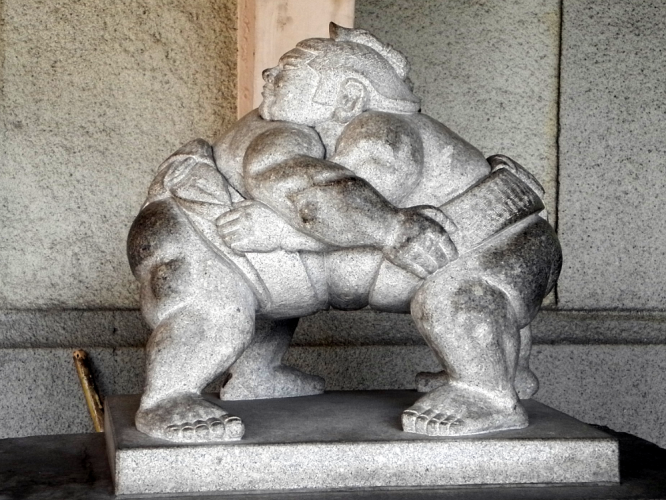 Sumo wrestlers stone sculpture, visiting a sumo tournament